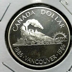 1986-CANADA-SILVER-DOLLAR-VANCOUVER-PROOF-BRILLIANT-UNCIRCULATED-CROWN