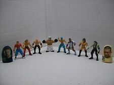 a set of 8 micro wrestlers and one set of cloth wwe thumb wrestlers