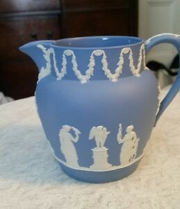 "WEDGWOOD JASPERWARE CREAM ON PALE BLUE CUPID AND DUTCH SACRIFICE 4 3/4"" JUG"