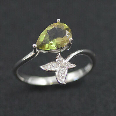 A silver ring with Natural Turkish Color Change Diaspore and a lot of small zirconia stones around it 925 Sterling Silver rhodium plated