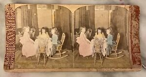 antique stereoview photos Of Kids At A Table With Dolls Having Tea