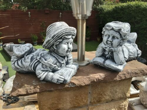 HAND PAINTED CONCRETE GIRL and BOY READING GARDEN ORNAMENT.