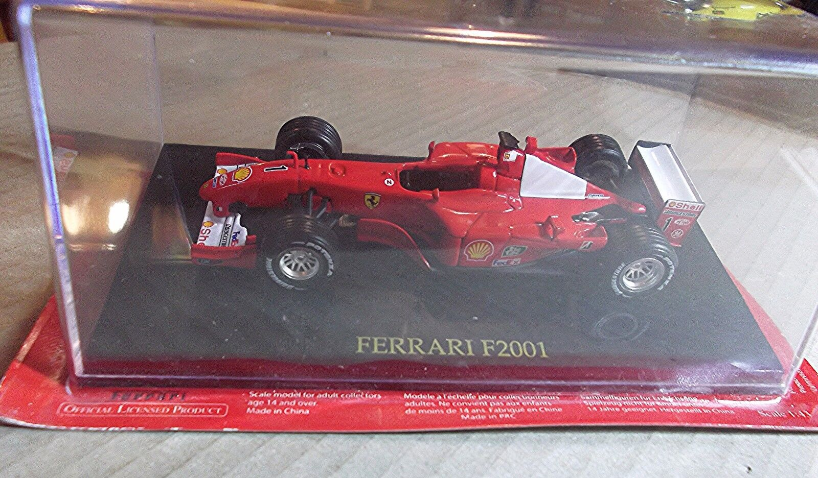 128164080  FERRARI F2001 M. SCHUMACHER  1 43 SCALE  OFFICIAL PRODUCT  RED No 1