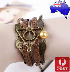 Harry-Potter-Deathly-Hallows-Golden-Snitch-and-Owl-Angel-Wing-Leather-Bracelet