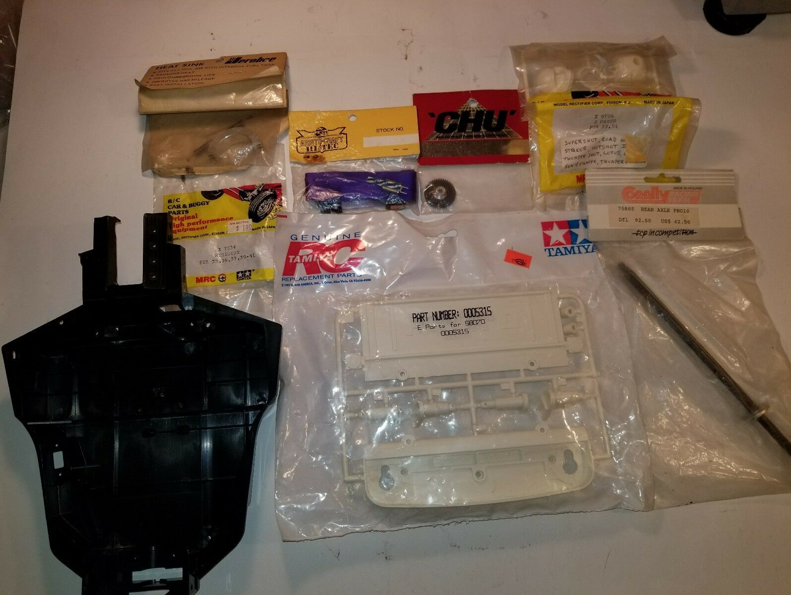 NEW, Vintage Original Tamiya and and and assorted top of the line RC Car parts. d7285c