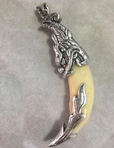 Wolf/'s teeth pendant set with Tibetan silver charms pendant