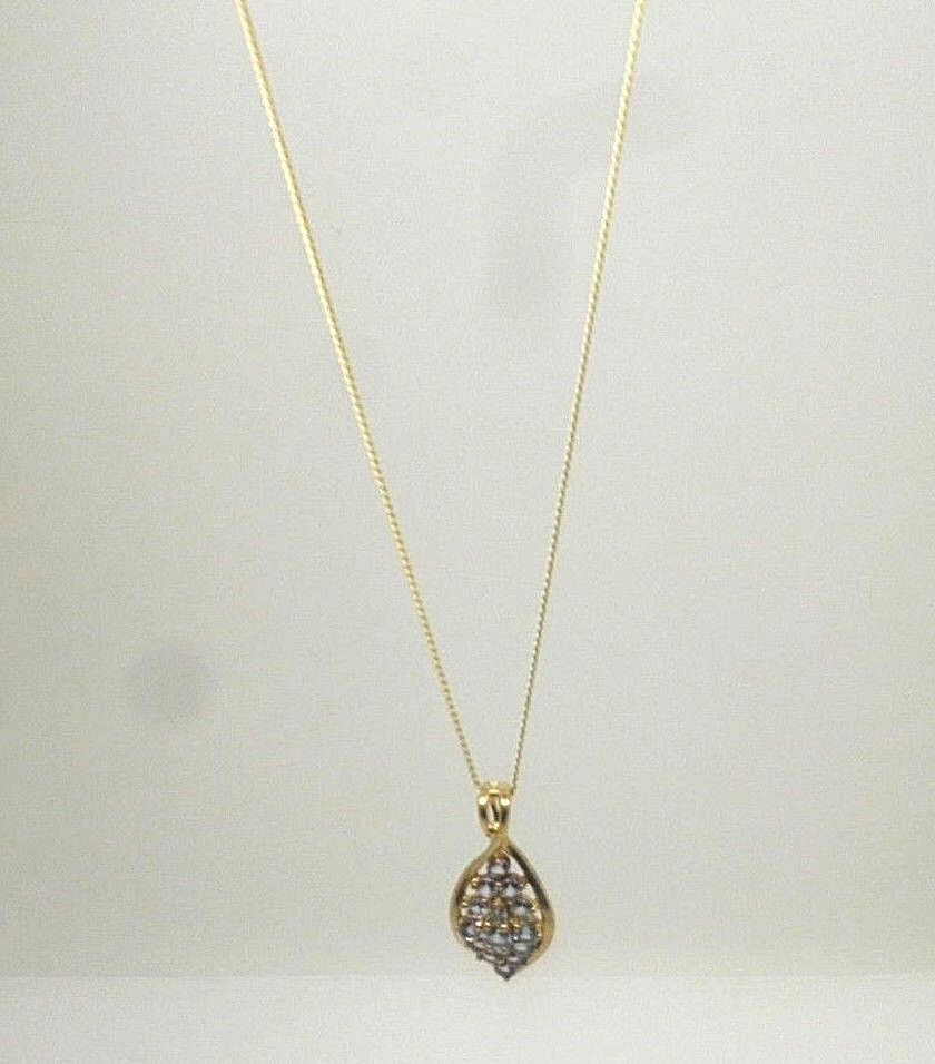 9ct yellow gold round cut claw set Iolite cluster pendent with 18' curb chain
