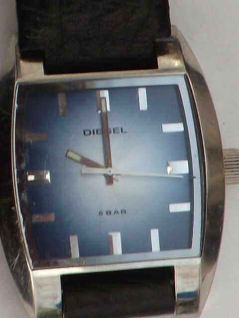a vintage gents stainless steel cased blue dial