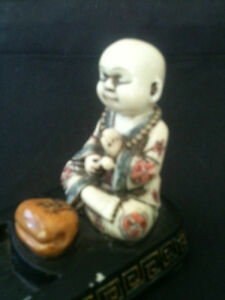 PEACEFUL-POLISHED-RESIN-CHILD-BUDDHA-INCENSE-HOLDER-285mm-LONG-x-60mm-WIDE