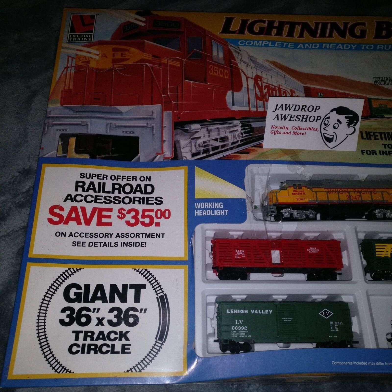 VINTAGE NEW ELECTRIC TRAIN SET HO SCALE LIGHTNING BOLT EXPRESS (SOME BOX DAMAGE)