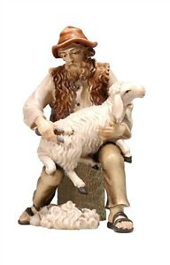 Shepherd-sitting-with-sheep-statue-wood-carving-for-Nativity-set-mod-912