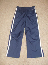 "NIKE NAVY Tracky bottoms STRETCH WAIST 28"" LENGTH 27"" ZIPS AT BOTTOM KNEE TUCKS"