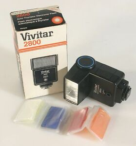 FLASH, FITS ANY CAMERA,W/BOX INSTRUCTIONS AND FILTER SET, WORKING CONDITION.
