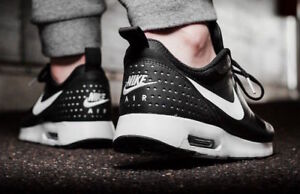 fd3ca88484 Nike Air Max Tavas Black White 705149 009 Mens Sneakers Sizes 8-13 ...