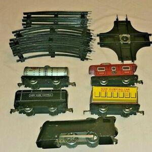 Marx Tinplate Wind-up Train Set with Track. Side Dump Car and Tank Car.