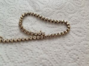 Bracciale-tennis-in-oro-14kt-e-0-50-di-brillanti