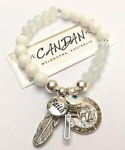 Evil-Eye-Mati-Jade-Bracelet-With-Saint-Christopher-Faith-Cross-Angel-Wing-Charms