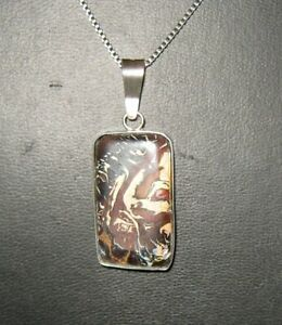 A very distinctly patterned DOUBLE SIDED boulder opal pendant from Yowah Queensland