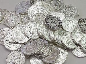 1 pack with 50 pieces St. Benedict medal double sided. silver measures one inch