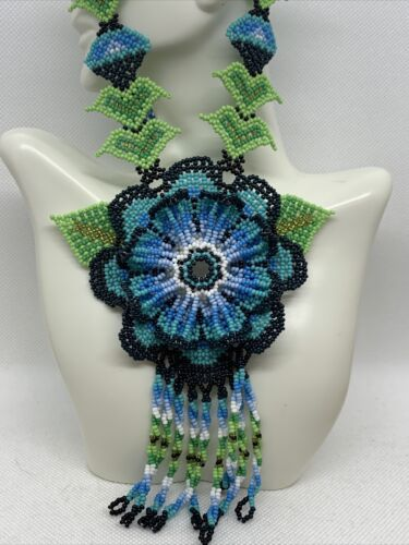 Huichol Beaded Pendant with traditional star design in pinkgreengold