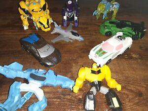 Transformer Lot of 9 - 3 Auto, 2 Dino, 1 Dog?, 1 Jet Fighter, 2 McDonalds Mixed