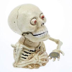 skeleton hand coin bank
