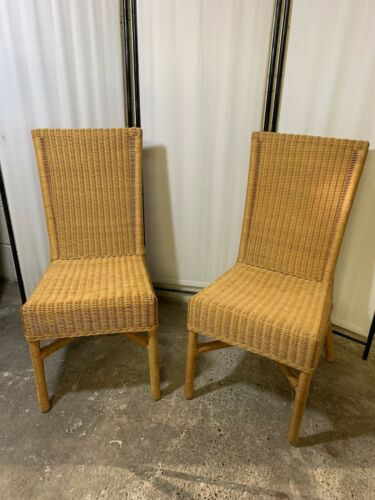 Two High Backed Rattan Chairs