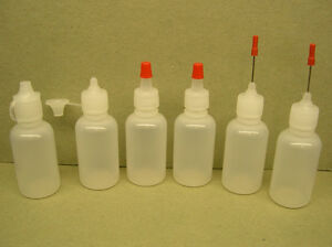Assortment-of-Six-1oz-Plastic-Bottles-w-Caps