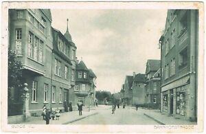 Ansichtskarte-Buende-Westfalen-Blick-in-die-Bahnhofstrasse-mit-Passanten-1914