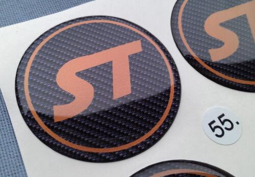 4x ST CARBON emblemi COPRIMOZZO PER CERCHIONI COPERCHIO 55mm in Silicone Adesivo st55co