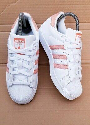 peach and white adidas