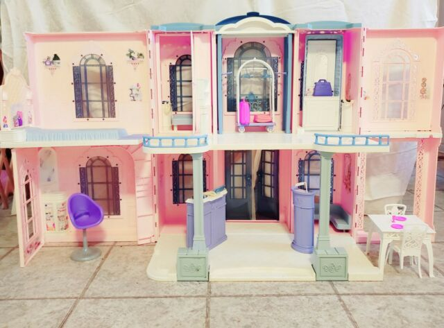 Vintage Barbie Grand Hotel Foldable Doll House With working electronics.