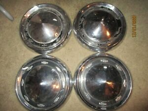 USED-SET-1956-CHEVROLET-CAR-DOG-DISH-HUB-CAPS-FOUR-HAVE-DENTS-PAINT-ISSUE-CLEAN