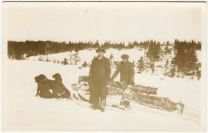Winter-Men-with-Dog-Sledge-Hauling-Pine-Logs-in-Snow-Real-Photo-Postcard