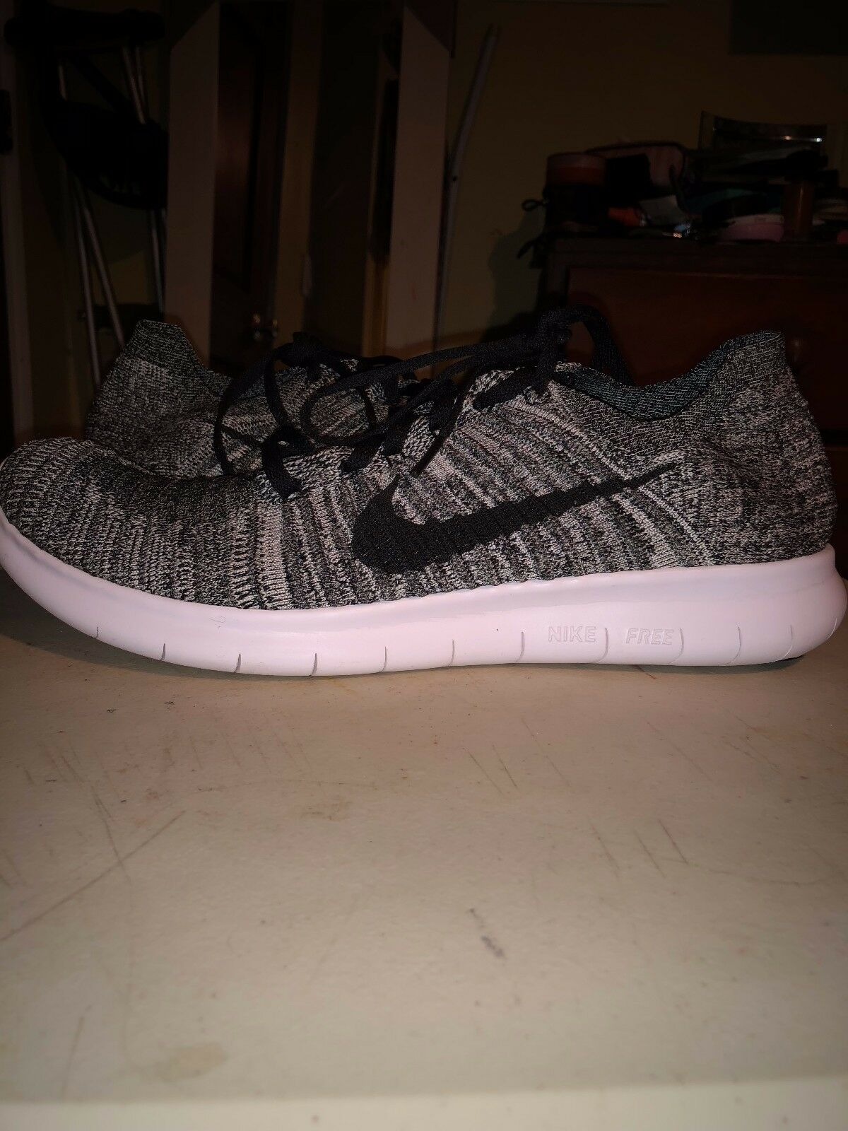 New shoes for men and women, limited time discount nike free rn flyknit in good condition , grey and white and black, used once