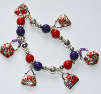 Pocketbook Bracelet / Silver-tone / Red Hat Theme Stretch Beaded Bracelet