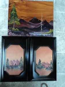 A set of three pieces vintage hand painted on wood lake scene wall hangings