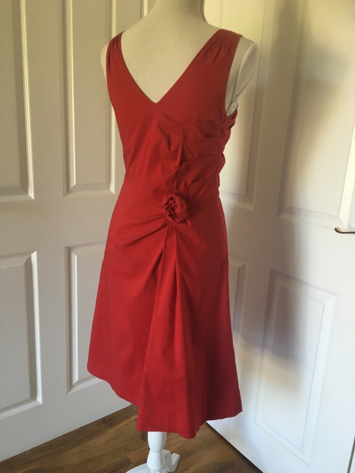 Beautiful Red Coast size 8 with pink detail