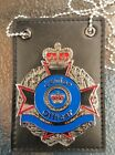 Junior Officer Badge Australia Qld police on leather holder