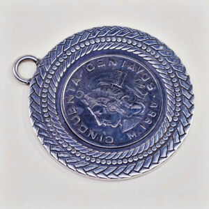 Sterling-Silver-Mexican-1980-centavos-coin-set-in-a-herringbone-twist-lariat