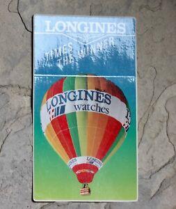 Vintage-Longines-watch-dealers-window-display-sticker-Made-in-Switzerland-NOS