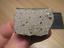 Meteorite-NWA-10079-Polymict-Diogenite-Metal-rich-Crusted-Endcut thumbnail 1