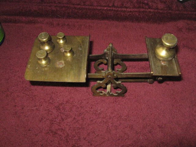 ANTIQUE BRASS POSTAL SCALE WITH FIVE WEIGHTS