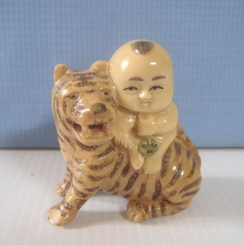 Vintage hand carved Japanese netsuke /'boy on tiger/' late 1900s cast resin unused