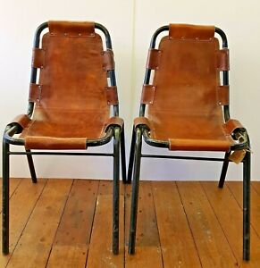 A-Pair-of-original-Charlotte-Perriand-Les-Arcs-Chairs-in-Cognac-Leather-C-1960