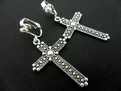 A PAIR OF TIBETAN SILVER DANGLY CROSS CRUCIFIX CLIP ON EARRINGS. NEW.