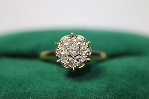14k 3.3 Gr Yellow Gold Ring with 7 round diamonds 1/2 Carat Total Size 8.5 JSH