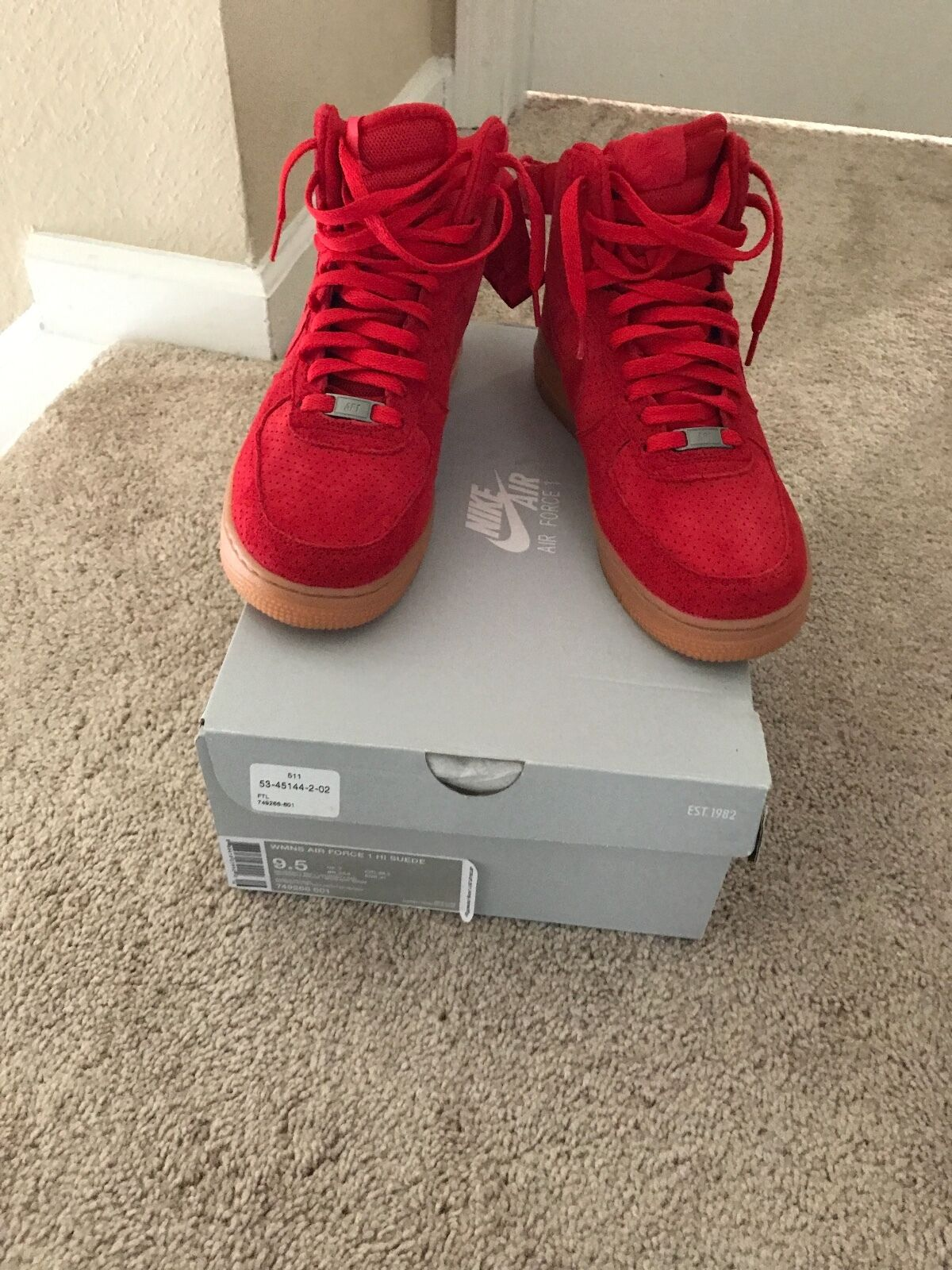 Red Air Force 1's Ladies Suede. Worn once, still have box and reciept.