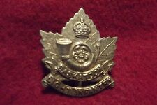 WW II/Pre WW II Canadian Cap Badge To The Saskatoon Light Infantry (M.G.)