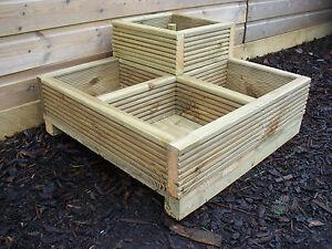 Corner square decking wood garden planter timber planter for Garden decking planters
